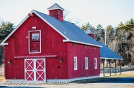 The main building welcomes visitors with information about the various programs and events at the farm